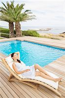 Woman relaxing by pool Stock Photo - Premium Royalty-Freenull, Code: 6113-07159689