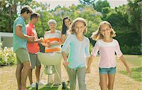 Family relaxing together in backyard Stock Photo - Premium Royalty-Freenull, Code: 6113-07159704