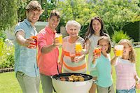 Family barbecuing together in backyard Stock Photo - Premium Royalty-Freenull, Code: 6113-07159712