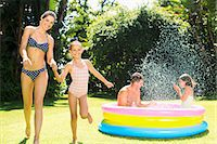 Family playing together in backyard Stock Photo - Premium Royalty-Freenull, Code: 6113-07159718