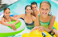 Family swimming together in pool Stock Photo - Premium Royalty-Freenull, Code: 6113-07159726