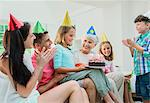 Family celebrating older womans birthday
