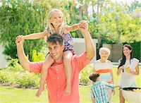 Father carrying daughter on shoulders Stock Photo - Premium Royalty-Freenull, Code: 6113-07159747
