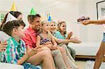 Family celebrating girls birthday