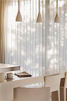 Breakfast bar in modern kitchen Stock Photo - Premium Royalty-Freenull, Code: 6113-07159851