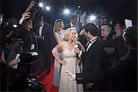 Female celebrity being interviewed on red carpet Stock Photo - Premium Royalty-Freenull, Code: 6113-07159895
