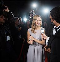 Celebrity being interviewed on red carpet Stock Photo - Premium Royalty-Freenull, Code: 6113-07159918