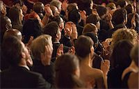 Rear view of clapping theater audience Stock Photo - Premium Royalty-Freenull, Code: 6113-07159984