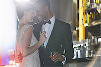 Well dressed couple hugging in luxury bar Stock Photo - Premium Royalty-Freenull, Code: 6113-07159988