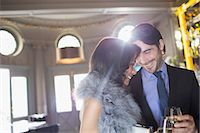 Well dressed couple drinking champagne in luxury bar Stock Photo - Premium Royalty-Freenull, Code: 6113-07159991
