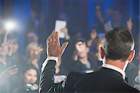 Rear view of male celebrity waving to paparazzi Stock Photo - Premium Royalty-Freenull, Code: 6113-07160001