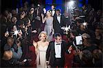 Well dressed celebrities waving to paparazzi on red carpet Stock Photo - Premium Royalty-Free, Artist: Dana Hursey, Code: 6113-07160023