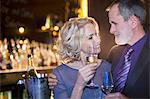Close up of well dressed couple drinking champagne Stock Photo - Premium Royalty-Free, Artist: Cultura RM, Code: 6113-07160051