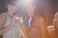 Well dressed women toasting champagne flutes Stock Photo - Premium Royalty-Freenull, Code: 6113-07160084