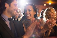 Close up of couple clapping in theater Stock Photo - Premium Royalty-Freenull, Code: 6113-07160100