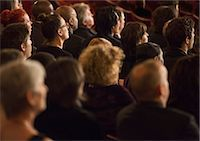 Attentive theater audience Stock Photo - Premium Royalty-Freenull, Code: 6113-07160112