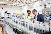 people working in factory - Supervisor and manager watching plastic bottles on conveyor belt Stock Photo - Premium Royalty-Freenull, Code: 6113-07160247