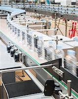 Bottles on conveyor belt in factory Stock Photo - Premium Royalty-Freenull, Code: 6113-07160255