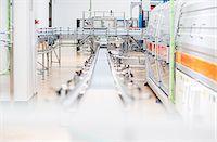 production - Conveyor belt in factory Stock Photo - Premium Royalty-Freenull, Code: 6113-07160262
