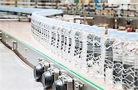 Bottles on conveyor belt in factory Stock Photo - Premium Royalty-Freenull, Code: 6113-07160313