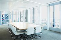 Empty meeting table in office Stock Photo - Premium Royalty-Freenull, Code: 6113-07160553