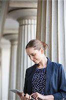 Businesswoman using digital tablet outdoors Stock Photo - Premium Royalty-Freenull, Code: 6113-07160678