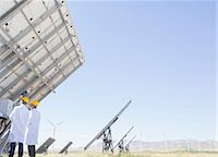 solar power - Scientists examining solar panel in rural landscape Stock Photo - Premium Royalty-Freenull, Code: 6113-07160902