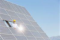 solar power - Worker examining solar panel in rural landscape Stock Photo - Premium Royalty-Freenull, Code: 6113-07160934