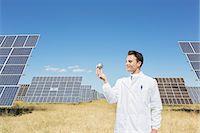 solar power - Scientist examining sphere by solar panels Stock Photo - Premium Royalty-Freenull, Code: 6113-07160940