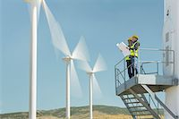 platform - Workers standing on wind turbine in rural landscape Stock Photo - Premium Royalty-Freenull, Code: 6113-07160944