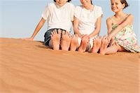 Children sitting on sand dune Stock Photo - Premium Royalty-Freenull, Code: 632-07161475