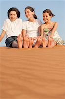 Children sitting on sand dune Stock Photo - Premium Royalty-Freenull, Code: 632-07161476