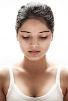 High contrast, head and one bare shoulder portrait of a young indian woman, shy condition Stock Photo - Royalty-Freenull, Code: 400-07167275