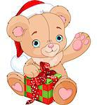 Christmas Teddy Bear holding gift box