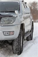 Snowy winter road ahead an unrecognizable car Stock Photo - Royalty-Freenull, Code: 400-07184754
