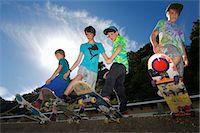 Portrait of four boys on skateboards Stock Photo - Premium Royalty-Freenull, Code: 614-07194657