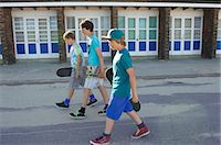 Three boys carrying skateboards Stock Photo - Premium Royalty-Freenull, Code: 614-07194659