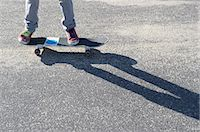 Detail of legs riding skateboard Stock Photo - Premium Royalty-Freenull, Code: 614-07194661