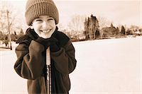 Boy Leaning on Hockey Stick Outdoors Stock Photo - Premium Rights-Managednull, Code: 700-07199507