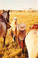 Two Girls with Horses Stock Photo - Premium Rights-Managednull, Code: 700-07199569