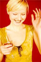 Woman with Glass of Wine Stock Photo - Premium Rights-Managed, Artist: Mick Ritzel, Code: 700-07199575