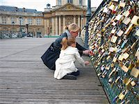 Mother and Daughter looking at Love Locks on Pont Des Arts, Paris, France Stock Photo - Premium Royalty-Freenull, Code: 600-07199703
