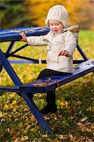 Portrait of Baby Girl at Picnic Table in Autumn, Scanlon Creek Conservation Area, Ontario, Canada Stock Photo - Premium Rights-Managednull, Code: 700-07199776