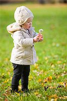 Portrait of Baby Girl with Dandelion in Autumn, Scanlon Creek Conservation Area, Ontario, Canada Stock Photo - Premium Rights-Managednull, Code: 700-07199778