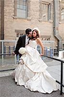 special moment - Groom kissing bride outdoors next to buildings, Toronto, Ontario, Canada Stock Photo - Premium Rights-Managednull, Code: 700-07199834