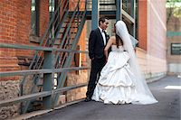 special moment - Bride and groom standing outdoors next to buildings, Toronto, Ontario, Canada Stock Photo - Premium Rights-Managednull, Code: 700-07199846