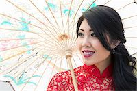 Close-up portrait of young woman holding Chinese parasol, Ontario, Canada Stock Photo - Premium Rights-Managednull, Code: 700-07199848