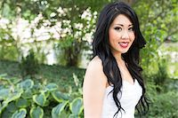 Close-up portrait of bride, standing in public garden, smiling and looking at camera, Ontario, Canada Stock Photo - Premium Rights-Managednull, Code: 700-07199853