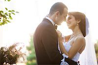 Close-up portrait of bride and groom standing outdoors, face to face, smiling and embracing, Ontario, Canada Stock Photo - Premium Rights-Managednull, Code: 700-07199861