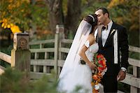 special moment - Bride and groom kissing outdoors in public garden, in Autumn, Ontario, Canada Stock Photo - Premium Rights-Managednull, Code: 700-07199868